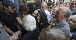 Pensioners struggle this week to enter a National Bank branch to receive part of their pension in Iraklio on the island of Crete .  Photograph:  Reuters/Stefanos Rapanis