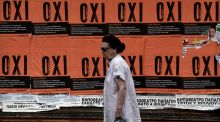A woman walks past posters reading 'No' ahead of a referendum on Greece's bailout  on Sunday. Photograph: AFP