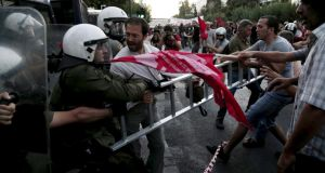 Anti-Euro protesters scuffle with riot police at the European Union representation offices in Athens, Greece, July 2nd, 2015. Photograph: Panayiotis Tzamaros/Reuters