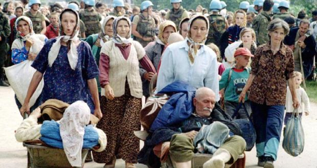 Bosnian refugees from the fallen eastern Bosnian enclave of Srebrenica walk from the United Nations base