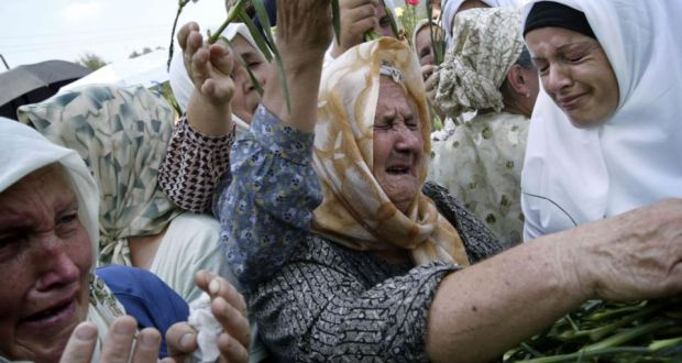 Bosnian Muslim women gather in Potocari to remember the dead. Photograph: Damir Sagolj/