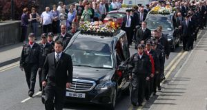 The funeral of Larry and Martina Hayes leaves  the Church of St Peter & Pauls, Athlone for the cemetary. Photograph: Collins