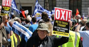 A protestor  at the  Central Bank in Dublin in support of the Greek solidarity movement. Photograph: Nick Bradshaw