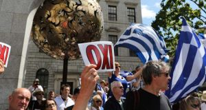 Protestors gather at the Central Bank in Dublin in support of the Greek solidarity movement. Photograph: Nick Bradshaw