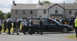 The coffin of mother-of-two Lorna Carty, a victim of the Tunisia terror attack is carried in a hearse, escorted by players from Meath GAA and Dunderry GAA, from the Church of the Assumption Robinstown, Co Meath. Photograph: PA