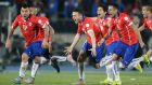 Chile players celebrate after defeating Argentina in the Copa America 2015 final. Photograph: Jorge Adorno/Reuters