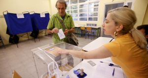 A man prepares to cast his vote in Athens on Sunday. Photograph: Jean-Paul Pelissier/Reuters
