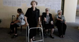 Women wait to cast their ballot at a voting centre during a referendum in Athens. Photograph: Yannis Kolesidis/EPA