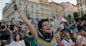 Supporters of No on the referendum celebrate after the first figures were officially announced, in Athens, Greece. Photograph: Orestis Panagiotou/EPA
