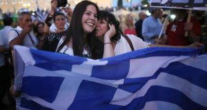 People celebrate in front of the Greek parliament as early polls predict a win for the Oxi, or No, campaign in the Greek austerity referendum. Photograph: Getty