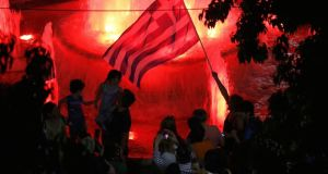 No supporters celebrate near the Greek parliament in Syntagma Square, Athens on Sunday night. After a resounding No vote in the referendum  the focus will turn to Frankfurt and the ECB's next move.   Photograph: Yannis Behrakis/Reuters