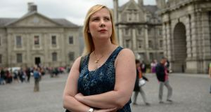 "Sinéad Pembroke works in Trinity College Dublin's School of Nursing and Midwifery: ""I can't think about buying a house or starting a family"". Photograph: Dara Mac Donaill"