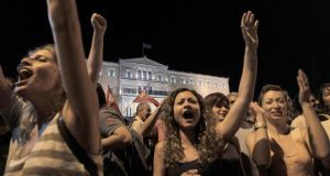 Supporters of the No campaign react during the results of the referendum in Athens. Photograph: ORESTIS PANAGIOTOU/EPA