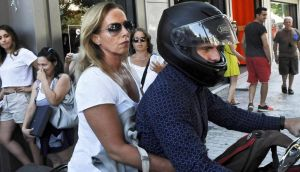 Greece's former finance minister Yanis Varoufakis drives his motorcyle with his wife Danae Stratou after exiting the finance ministry in Athens. Photograph: Fotis Plegas/EPA
