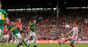 Kieran Donaghy scores Kerry's first goal in their drawn Munster Senior Football Championship Final clash with Cork last Sunday. Photograph: Ryan Byrne/Inpho