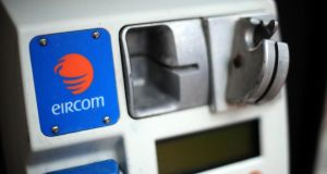 The Eircom company logo  on a pay phone. Figures from Eircom show that between June 2014 and May 2015 there were, on average, 11.6 calls made per month from each pay phone nationally and 14.4 per month in Dublin.  File photograph: Aidan Crawley/Bloomberg