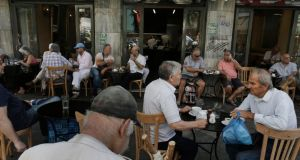 Athenians enjoy their coffee at a cafe, two days after the referendum. Photograph:  Yannis Kolesidis/EPA
