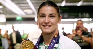 Boxer Katie Taylor when arriving back at Dublin Airport after she won gold at the 2015 European Games, held in Baku, Azerbaijan, last month. Photograph: PA.