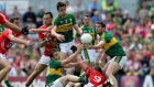 David Moran, centre,  in action for Kerry against Cork in Sunday's drawn Munster final. Photograph: Donall Farmer/Inpho
