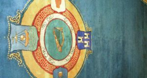 The New Ireland Carpet features a woven central medallion with a harp and a crest of the four provinces