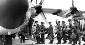 Long tradition of peacekeeping ... Irish soldiers boarding plane from Baldonnel   for Congo as part of the 1960 UN   mission. in which  nine would die in an ambush   at Niemba.