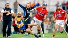 Clare's Conor McGrath and Damien Cahalane of Cork clash during their qualifier round two meeting in Thurles. Photograph: James Crombie/Inpho