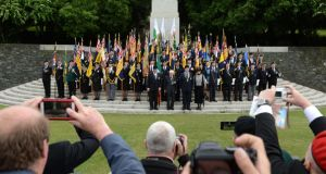 The colour party poses for a photograph after taking part in the annual Ceremony of Remembrance, organised by the Royal British Legion, Republic of Ireland, at the National War Memorial Gardens in Islandbridge on Saturday. Photograph: Dara Mac Dónaill/The Irish Times