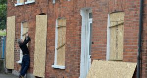 Some of the Chobham Street houses in east Belfast being boarded up before a  bonfire on July 11th, 2015. Photograph: Charles McQuillan/Getty Images