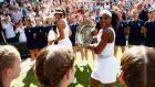 Serena Williams leaves court with the Venus Rosewater Dish after her victory in the women's singles against Garbine Muguruza. Photograph: Julian Finney/Getty Images.