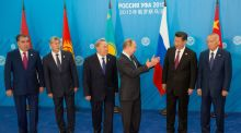 Russian president Vladimir Putin gestures to Chinese president Xi Jinping as other heads of state look on during the Brics/SCO summits in Ufa. Photograph: Ria Novosti/Getty Images