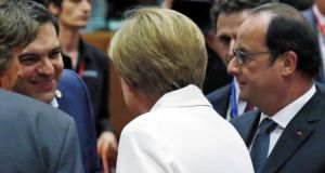 Greek prime minister Alexis Tsipras meets German chancellor Angela Merkel and French president François Hollande at Sunday's euro zone leaders' summit in Brussels. Photograph: François Lenoir/Reuters