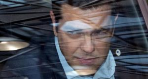 Greek prime minister Alexis Tsipras arrives in his car at a euro zone leaders summit in Brussels, Belgium. Photograph: Reuters