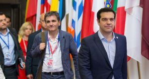 Greek prime minister Alexis Tsipras (right) and  finance minister Euclid Tsakalotos depart following all-night bailout talks in Brussels. Photograph: Bloomberg