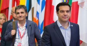 Greek prime minister Alexis Tsipras (right), and his finance minister  Euclid Tsakalotos  depart following all-night bailout talks in Brussels.