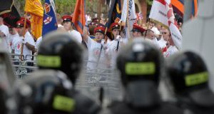 Loyalists break through a police barrier as they are prevented from progressing on the return journey towards the controversial Ardoyne flashpoint the Twelfth of July parade on July 13, 2015 in Belfast. Photograph: Charles McQuillan/Getty Images