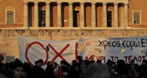 Anti-austerity protesters demonstrate in front of the Greek parliament in Athens on Monday. Prime minister Alexis Tsipras returned from Brussels to a gathering storm at home. Photograph: Orestis Panagiotou/EPA