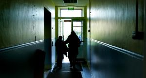 End of school day  .... parent and  child at   Bracken Educate Together at Sunshine House in Balbriggan. Photograph: Kate Geraghty, Irish Times