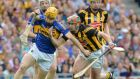 Kieran Bergin battles past Kilkenny's Eoin Larkin in last year's replayed All-Ireland final. Photograph: Alan Betson