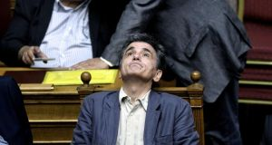 Greek finance minister Euclid Tsakalotos attends a parliament session in Athens, on Wednesday. Photograph: Getty
