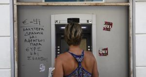 ATM withdrawals are limited to €60, but some banks can run out of €20 notes, in effect making the limit €50. Photograph: Reuters