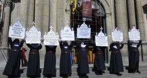 Pro-choice ...  members of the Bolivian feminist group 'Mujeres Creando' ('Women Creating') dressed as nuns protest  outside the Cathedral of La Paz ahead of the recent visit of Pope Francis. Photograph:   EPA/ABI Handout