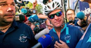 Cyclist Lance Armstrong of the U.S. speaks to journalists before taking part in Geoff Thomas's 'One Day Ahead' charity event during a stage of the 102nd Tour de France cycling race from Muret to Rodez, France. Photo: Fred Lancelot/Reuters