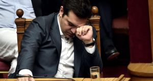 Alexis Tsipras did not order the summary expulsions of rebel MPs in the immediate aftermath of the vote. Photograph: Aris Messinis/AFP/Getty Images