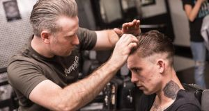 Cutting hair at Sam's Barber's on Ormond Quay in Dublin