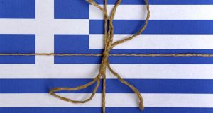 "Bail-out, bail twine ... the Greek flag is bound up with a parcel string to illustrate 'bailout package"" in Kaufbeuren, Germany. Photograph: EPA/Karl-Josef Hildenbrand."