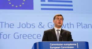 EU commissioner Valdis Dombrovskis, speaks at a news conference on Wednesday. He has confirmed the troika is to return to Greece for negotiations. Photograph: Julien Warnand/EPA