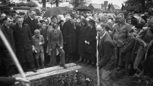 A crowd attends the funeral in Sligo. Standing nearest the grave are his grieving family. Photograph: Haywood Magee/Picture Post/Getty Images
