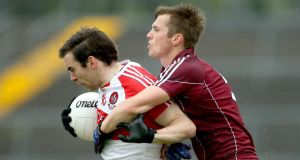 Liam Silke tackles Benny Heron during Galway's victory over Derry in Salthill. Photograph: Inpho