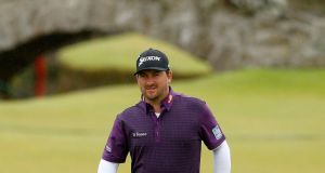 Graeme McDowell made a strong start to his third round in the British Open before stalling and signing for a 70. Photograph: PA