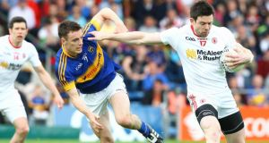 Tyrone's Conor Clarke holds off the challenge of Tipperary's Alan Campbell during the qualifier at Semple Stadium on Saturday. Photograph: Ken Sutton/Inpho